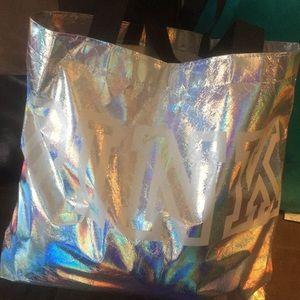 Pink duffel bag silver an white